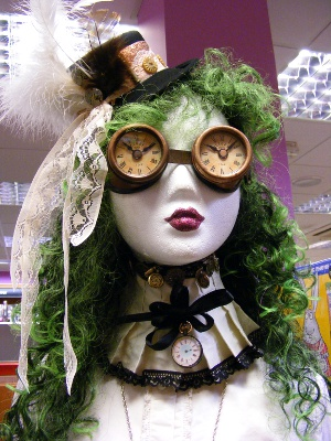 Steampunk Fashions: A polystyrene head with a mini hat, goggles made from clock faces and other clock jewellery